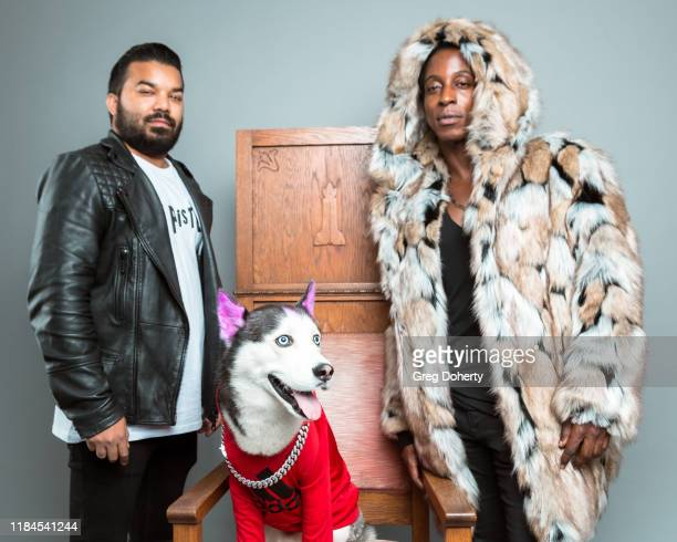 Actor Adrian Dev celebrity dog Swaggy Wolfdog and model Shaka Smith pose for a portrait as Project Save Our Surf visits TAP The Artists Project on...