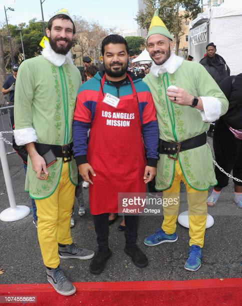 Actor Adrian Dev poses with Elves at the Los Angeles Mission Christmas On Skid Row held at Los Angeles Mission on December 21 2018 in Los Angeles...