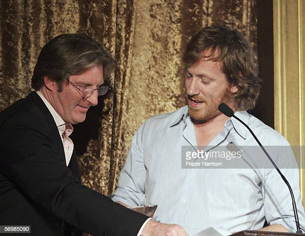 Actor Adrian Dunbar on stage with Composer David Holmes who was honored at the USIreland Alliance 'Oscar Wilde Honoring Irish Writing in Film event...
