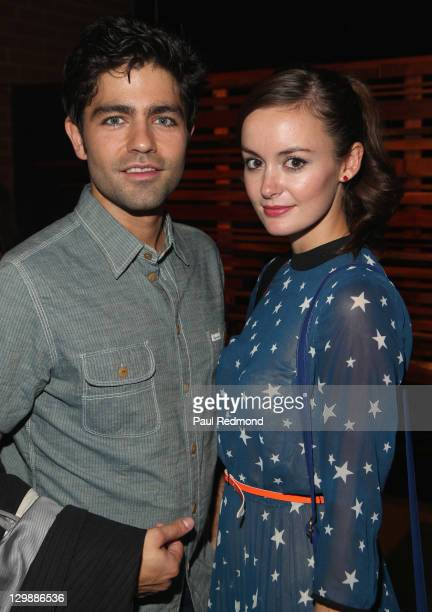 Actor Adrian Grenier and model Emily Caldwell attend SHFT PopUp Gallery And Shop Presented By Sungevity Opening Night Celebration on October 20 2011...