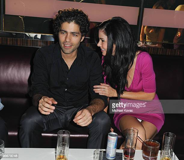 Actor Adrian Grenier and model Jayde Nicole mingle at the amfAR Cocktail Party PokerStars Red Carpet And Party at Aura Nightclub on January 9 2010 in...