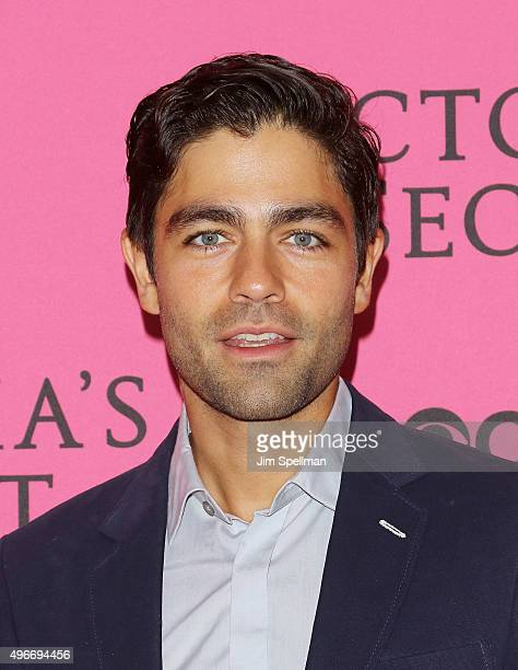 Actor Adrian Grenier attends the 2015 Victoria's Secret Fashion Show pink carpet arrivals at Lexington Armory on November 10, 2015 in New York City.