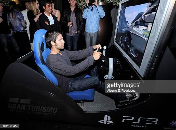 Actor Adrian Grenier plays Gran Turismo 5 as MercedesBenz celebrates PlayStation 3 Gran Turismo 5 featuring the SLS AMG at SLS Hotel on June 15 2010...