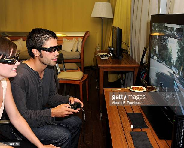 Actor Adrian Grenier plays Gran Turismo 5 on Sony 3D as MercedesBenz celebrates PlayStation 3 Gran Turismo 5 featuring the SLS AMG at SLS Hotel on...