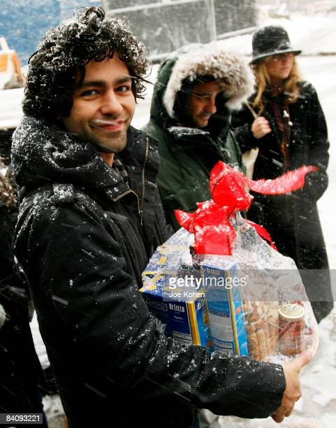 *EXCLUSIVE* Actor Adrian Grenier unloads City Harvest's new hybrid trucks delivering food to those in need in support of Feeding America on December...