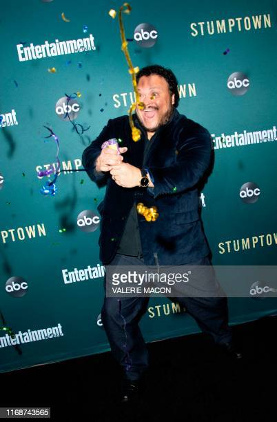 """Actor Adrian Martinez shoots confetti as he attends the premiere of ABC's """"Stumptown"""" at the Petersen Automotive Museum, September 16 in Los Angeles."""