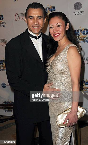 Actor Adrian Paul and costume designer Alexandra Tonelli arrives for Norby Walters' 22nd Annual Night Of 100 Stars Oscar Viewing Gala held at The...
