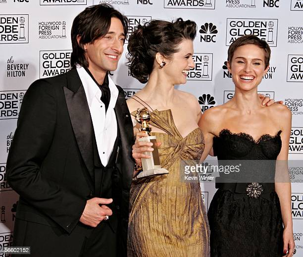 Actor Adrien Brody actress Rachel Weisz with her award for Best Supporting Actress for The Constant Gardener and actress Natalie Portman pose...