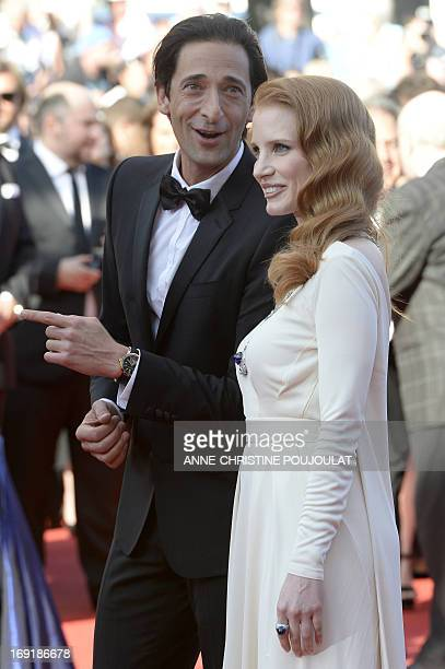 "Actor Adrien Brody and actress Jessica Chastain pose on May 21, 2013 as they arrive for the screening of the film ""Cleopatra"" presented in Cannes..."