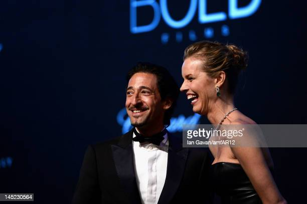 Actor Adrien Brody and Eva Herzigova appear during the 2012 amfAR's Cinema Against AIDS during the 65th Annual Cannes Film Festival at Hotel Du Cap...