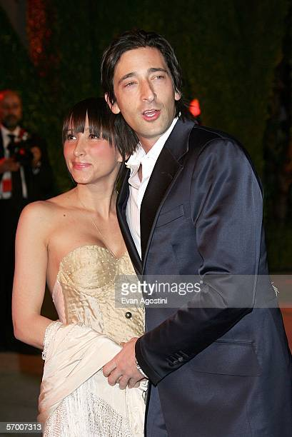 Actor Adrien Brody and guest arrive at the Vanity Fair Oscar Party at Mortons on March 5 2006 in West Hollywood California