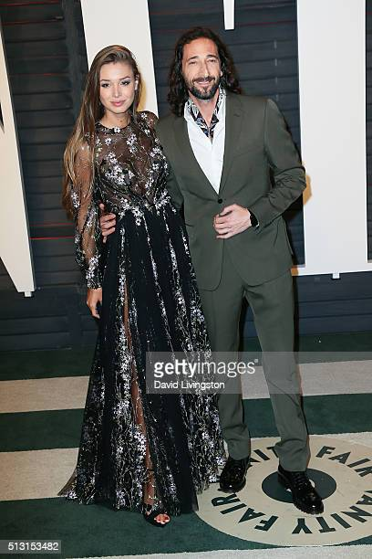 Actor Adrien Brody and Lara Leito arrive at the 2016 Vanity Fair Oscar Party Hosted by Graydon Carter at the Wallis Annenberg Center for the...