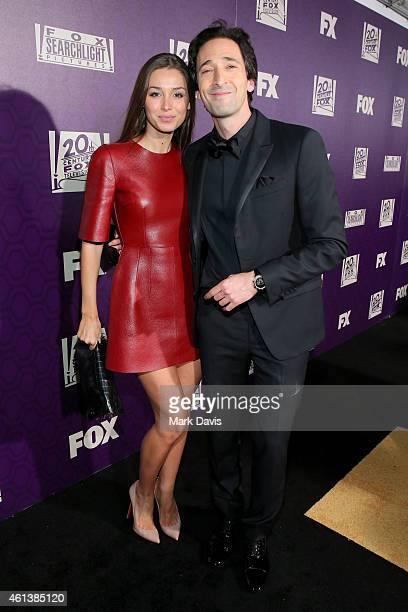 Actor Adrien Brody and Lara Leito attend The 72nd Annual Golden Globe Awards at The Beverly Hilton on January 11 2015 in Beverly Hills California