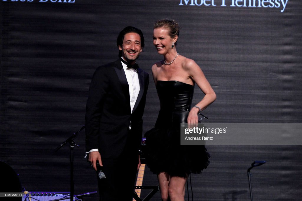 Actor Adrien Brody and model Eva Herzigova speak onstage during the 2012 amfAR's Cinema Against AIDS during the 65th Annual Cannes Film Festival at Hotel Du Cap on May 24, 2012 in Cap D'Antibes, France.