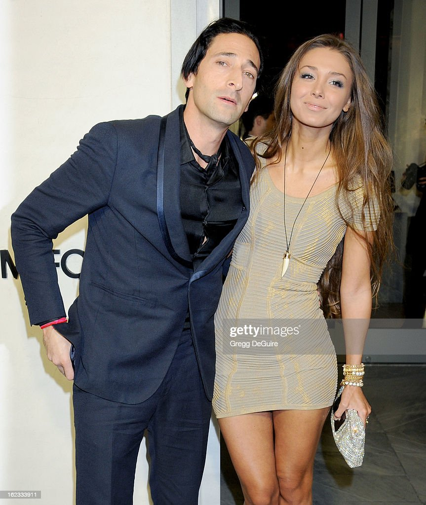 Actor Adrien Brody and model Lara Leito arrive at the Tom Ford cocktail party in support of Project Angel Food at TOM FORD on February 21, 2013 in Beverly Hills, California.