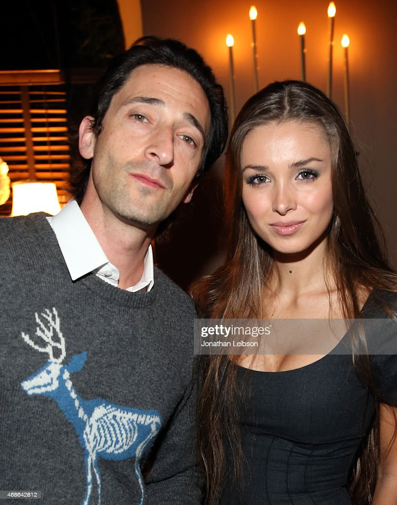 Actor Adrien Brody and model Lara Leito (R) attend the Variety and Formula E Hollywood Gala at Chateau Marmont on April 4, 2015 in Los Angeles, California.