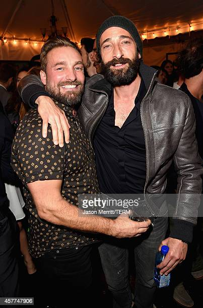 Actor Adrien Brody and photorgrapher Brian Bowen Smith attend the Brian Bowen Smith WILDLIFE show hosted by Casamigos Tequila at De Re Gallery on...