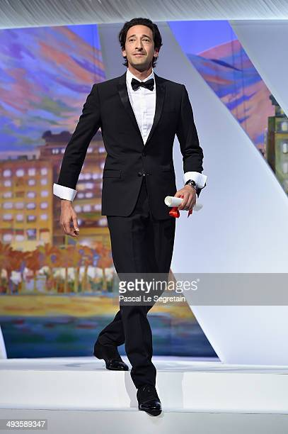 Actor Adrien Brody arrives on stage to present the Best Director award during the Closing Ceremony at the 67th Annual Cannes Film Festival on May 24...