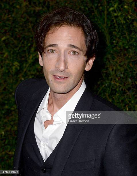 Actor Adrien Brody attends the Chanel and Charles Finch PreOscar Dinner at Madeo Restaurant on March 1 2014 in Los Angeles California