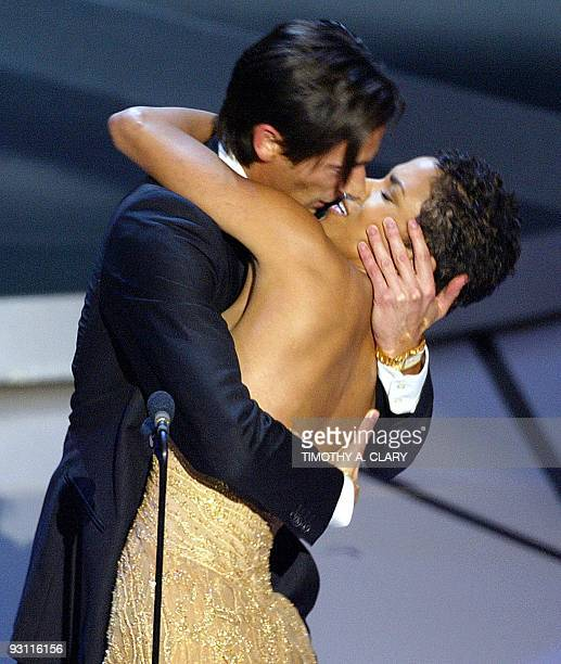 Actor Adrien Brody kisses presenter Actress Halle Berry as he accepts his Oscar for Performance by an actor in a leading role for his role in The...