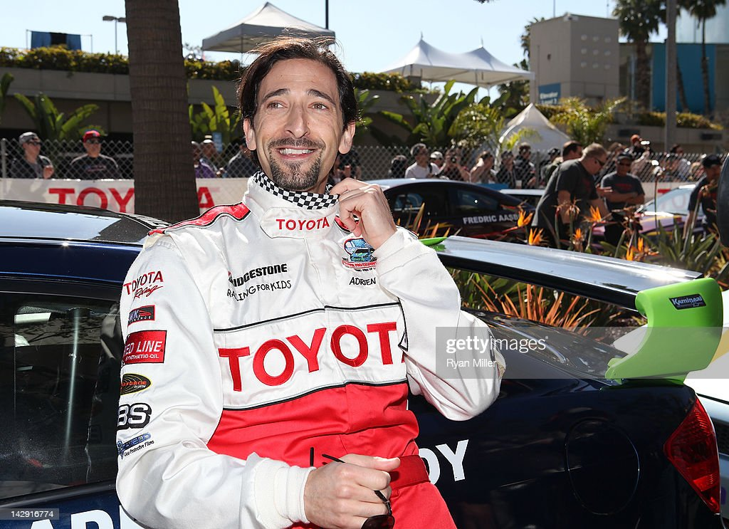 Actor Adrien Brody shows off his checkered flag scarf during the 36th Annual Toyota Pro/Celebrity Race held at the Toyota Grand Prix of Long Beach on April 14, 2012 in Long Beach, California.