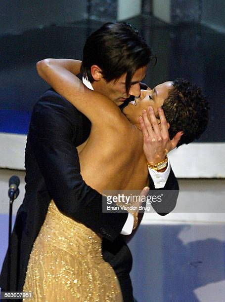 Actor Adrien Brody suprises presenter Halle Berry with a kiss after he won the Oscar for best actor for his work in The Pianist at the 75th annual...