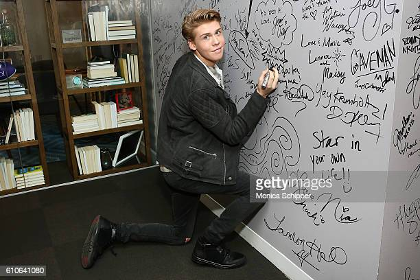 Actor Aidan Alexander signs the wall at AOL HQ when he visits for The Build Series Presents Aidan Alexander Discussing The New Movie 'Cowgirl's...