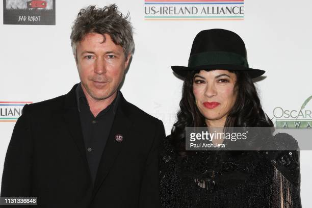 Actor Aidan Gillen and Musician Camille O'Sullivan attend the USIreland Alliance 14th Annual Oscar Wilde Awards at Bad Robot on February 21 2019 in...