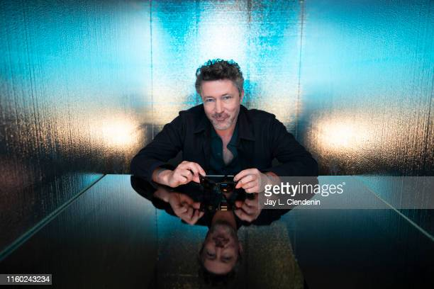 Actor Aidan Gillen of 'Project Blue Book' is photographed for Los Angeles Times at ComicCon International on July 20 2019 in San Diego California...
