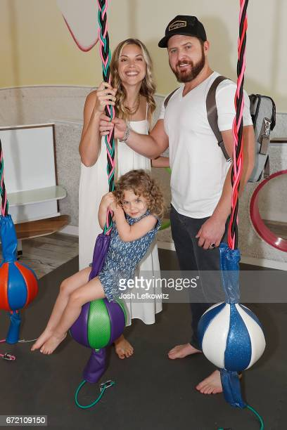 Actor AJ Buckley Abigail Ochse and their daughter Willow Phoenix attend the Henry Winkler book signing at WeVillage Flexible Childcare Center on...