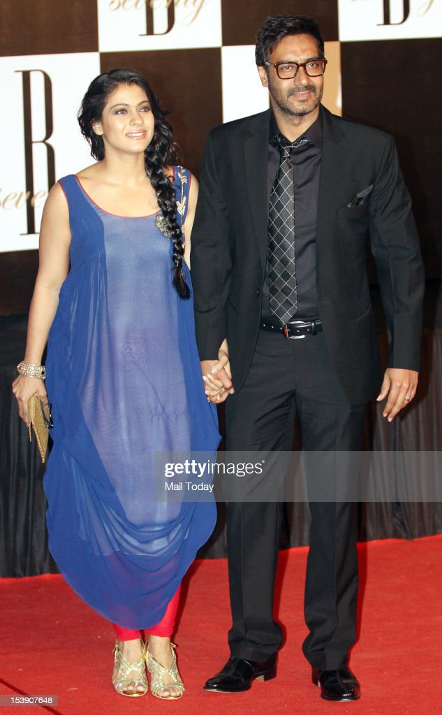 Actor Ajay Devgan and Kajol at a party on the eve of megastar Amitabh Bachchan`s 70th birthday in Mumbai on Wednesday