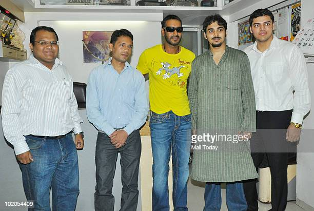 Actor Ajay Devgan meets his fans at an event in Mumbai on June 11, 2010.