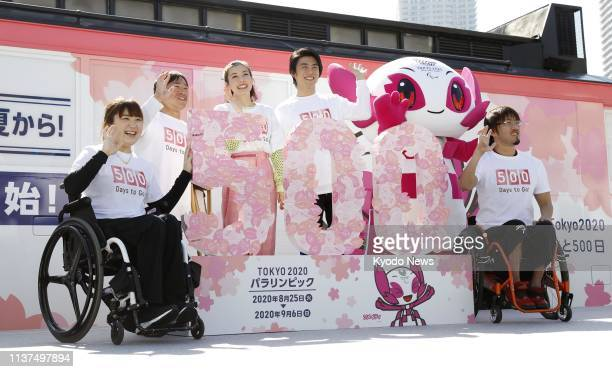 Actor Akiyoshi Nakao actress Riisa Naka and Paralympic athletes pose for a photo at an event in Tokyo on April 13 2019 just 500 days prior to the...