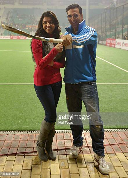 Actor Akshay Kumar and actress Kajal Aggarwal during the HIL match between Delhi Waveriders vs Punjab Warriors at MDC National stadium in New Delhi...
