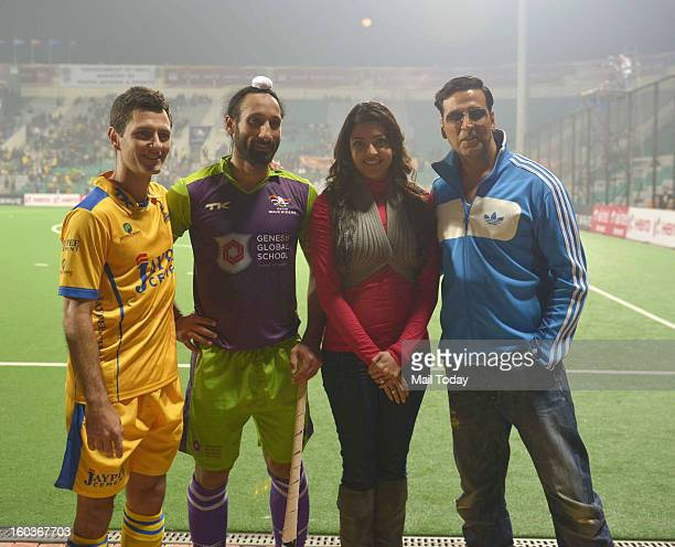 Actor Akshay Kumar and actress Kajal Aggarwal with the captains of Delhi Sardar Singh and Punjab Jaimie Dwyer during the HIL match between Delhi...