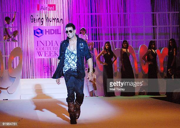 Actor Akshay Kumar walks the runway in support of fellow actor Salman Khan's foundation 'Being Human' on the second day of the HDIL India Couture...