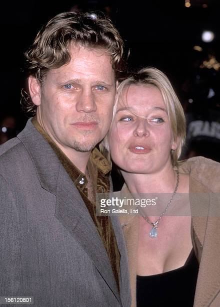 Actor Al Corley and wife Jessika Cardinahl attend the 'Palmetto' Westwood Premiere on February 17 1998 at Mann Village Theatre in Westwood California