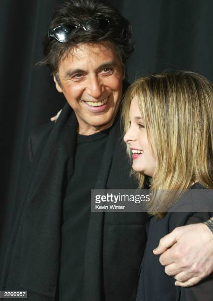 Actor Al Pacino and his daughter Julie Marie arrive at the premiere of The Recruit at the Cinerama Dome on January 28 2003 in Hollywood California