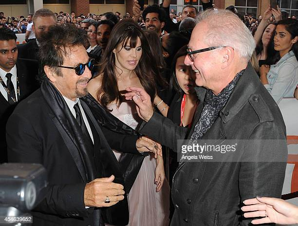 """Actor Al Pacino and Lucila Sola with director Barry Levinson arrive at """"The Humbling"""" Premiere during the 2014 Toronto International Film Festival at..."""