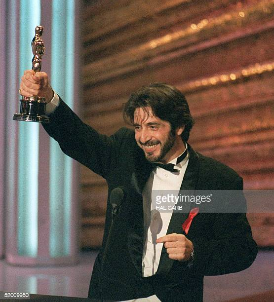 US actor Al Pacino holds up his Oscar during the 65th Annual Academy Awards ceremony 29 March 1993 after being presented the Best Actor award for his...