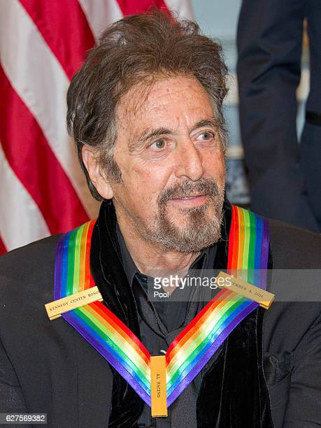 Actor Al Pacino one of the five recipients of the 39th Annual Kennedy Center Honors poses for a group photo following a dinner at the US Department...