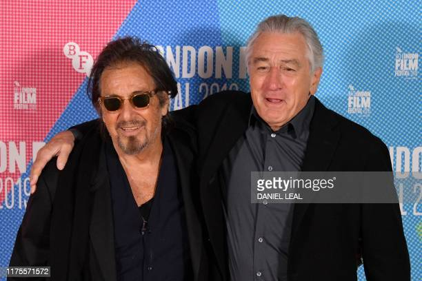 US actor Al Pacino poses with US actor Robert De Niro as they attend a photo call for the film The Irishman during the 2019 BFI London Film Festival...