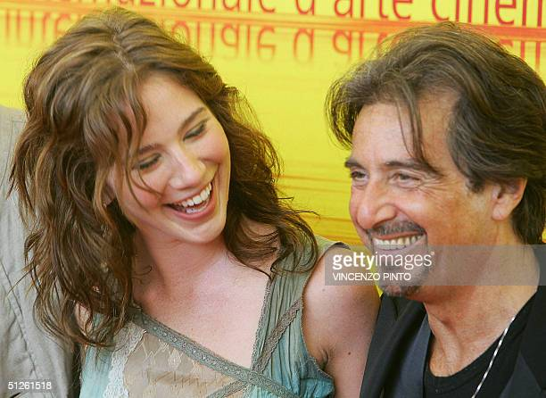US actor Al Pacino smiles with actress Lynn Collins at the Venice Lido 04 September 2004 Al Pacino and Collins are starring in an out of competition...