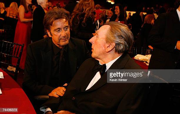 ACCESS** Actor Al Pacino talks with mentor Charles Laughton in the audience during the 35th AFI Life Achievement Award tribute to Al Pacino held at...