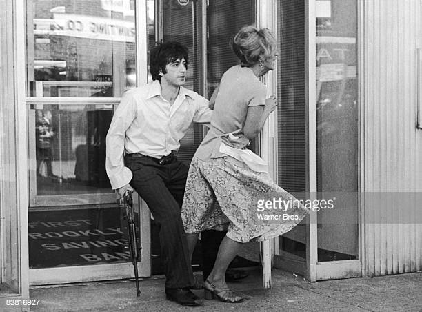 Actor Al Pacino tries to drag Penelope Allen into a bank during a robbery in a still from the film 'Dog Day Afternoon' directed by Sidney Lumet 1975