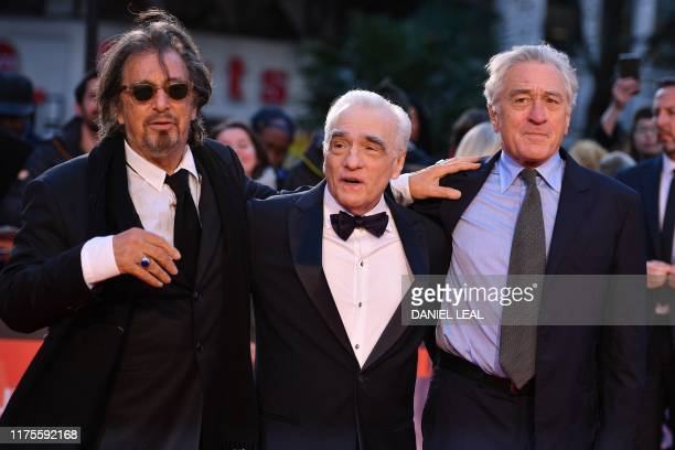 US actor Al Pacino US filmmaker Martin Scorsese and US actor Robert De Niro pose on the red carpet as they arrive to attend the international...