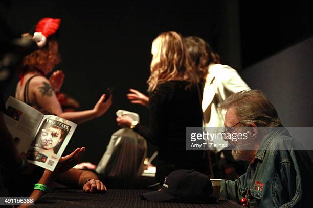 Actor Al Strobel who played on the TV series Twin Peaks the character Mike the 'onearmed man' signs authographs for fans during the sixth annual Twin...