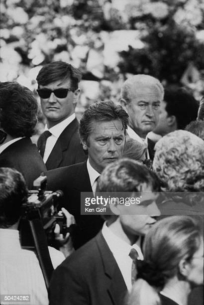 Actor Alain Delon amidst a group of mourners at the funeral of Italian businessman Stefano Casiraghi