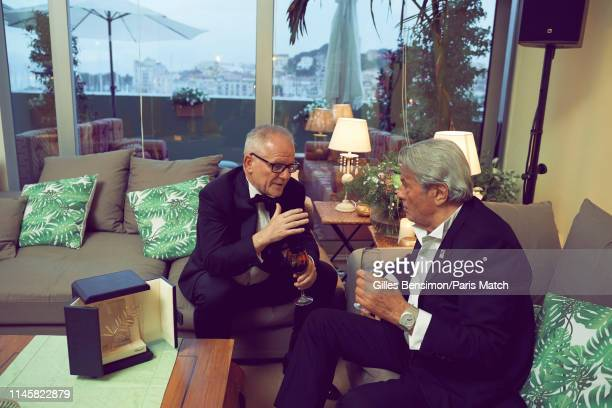 Actor Alain Delon attends the 72nd Cannes Film Festival 2019 who was honored with the Golden Palm for his acting career is photographed with Thierry...