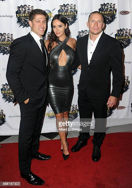 Actor Alain Moussi actress Sara Malakul Lane and actor Georges StPierre arrive for the Premiere Of RLJ Entertainment's Kickboxer Vengeance held at...